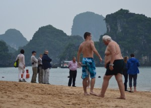 Tourists on Titop Beach, Best Halong Bay Overnight Cruise Tours from Hanoi