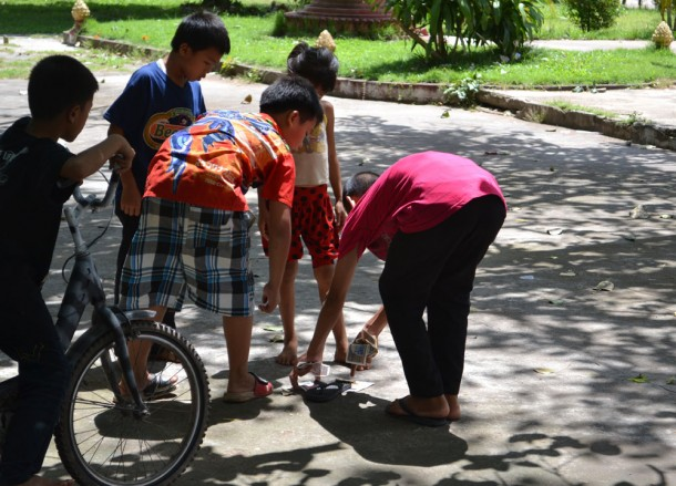 Kids Playing Petanque, Vientiane City Tour, Things to do in Laos