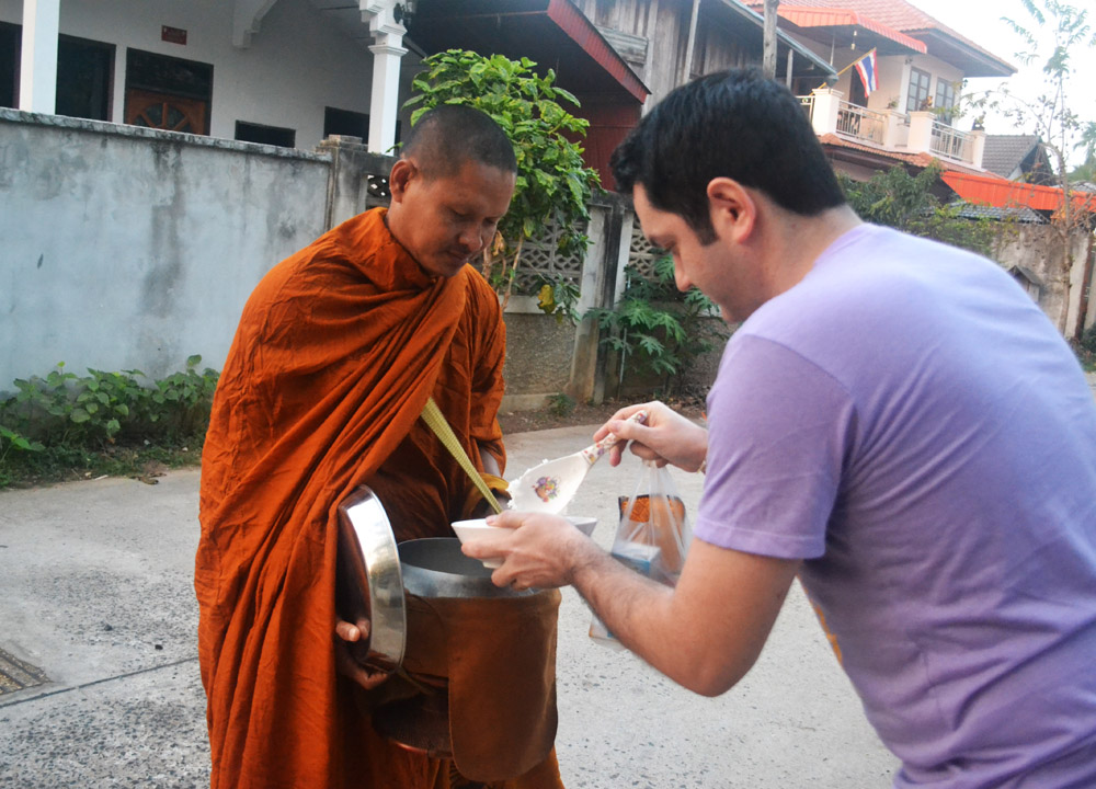 Allan Wilson Giving Rice to Monk, Living in Thailand, Nang Rong, Simple life Rural Thailand
