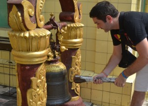 Hitting Gong at Temple, Sule Pagoda in Yangon Downtown, Myanmar