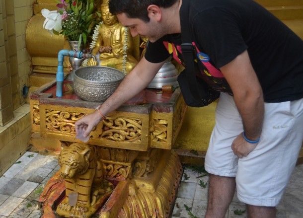 Pouring Water over Tiger, Sule Pagoda in Yangon Downtown, Myanmar