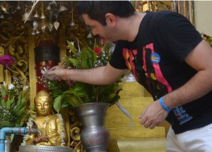 Pouring Water over Monk, Sule Pagoda in Yangon Downtown, Myanmar