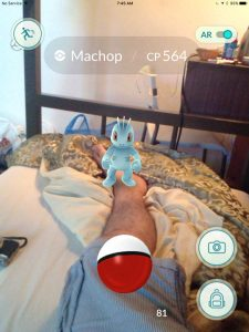 Machop in Bed, Playing Pokemon in Bangkok Thailand Traveller Expat Pokemon Go Game