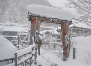 Bridge Crossing, Osenkaku Ryokan Takaragawa Onsen in Winter Snow